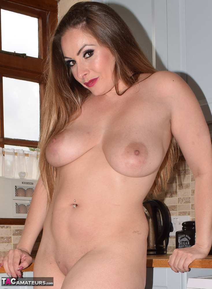 Busty amateur Sophia Delane gets naked in the kitchen